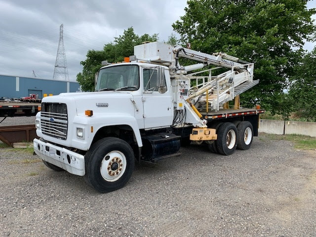 1992 Ford L8000 with Paxton-Mitchell 140-P Underbridge Attachment